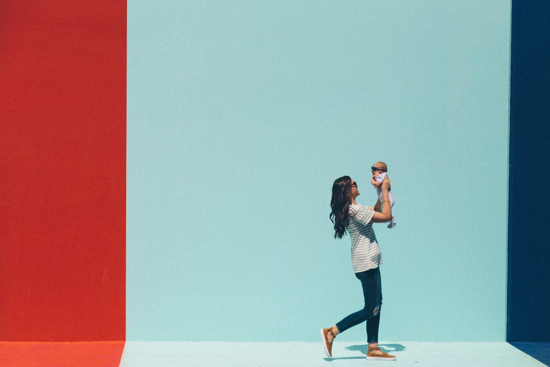 Stylish mum holding baby