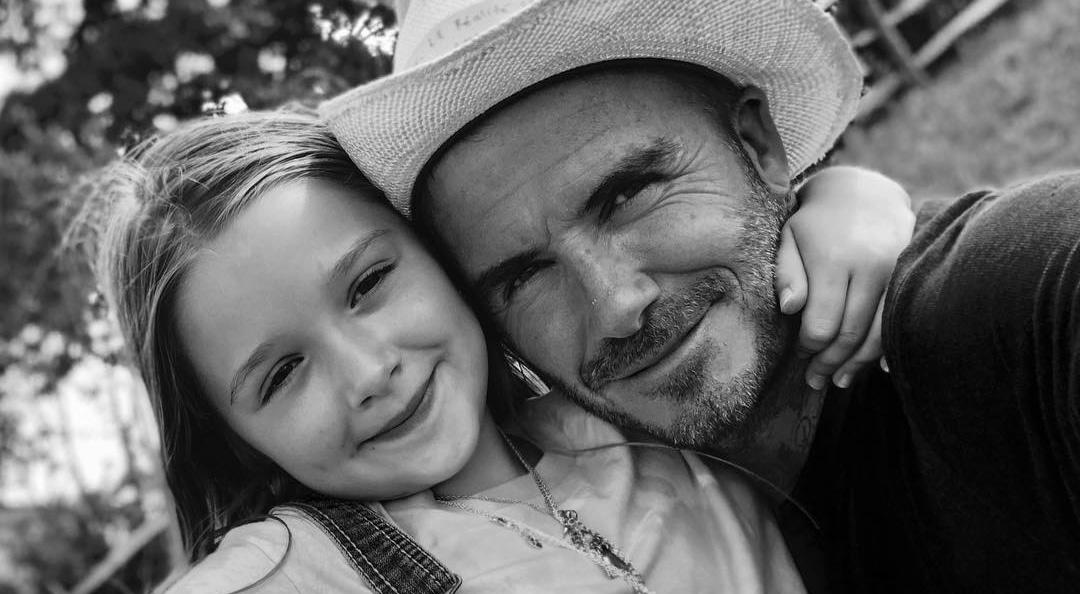 David Beckham with Harper smiling
