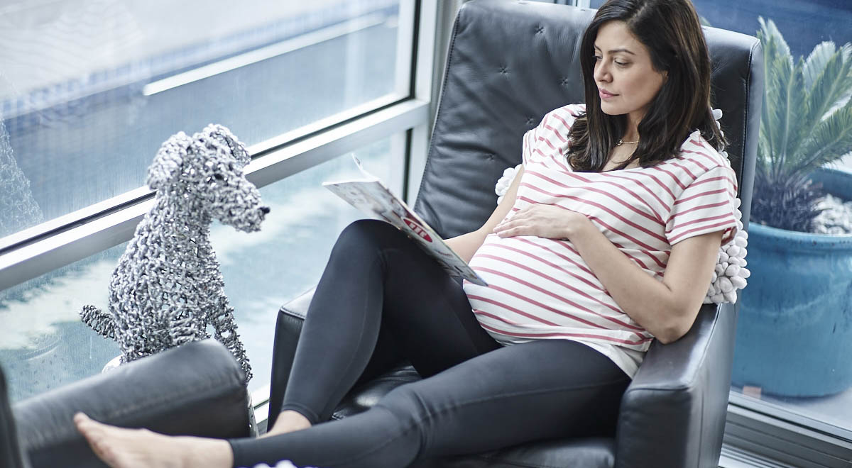 Pregnant women relaxing on couch