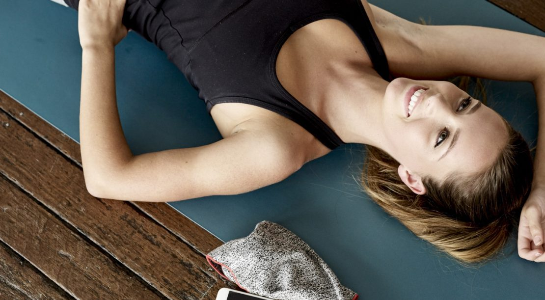 Woman on yoga mat exercising