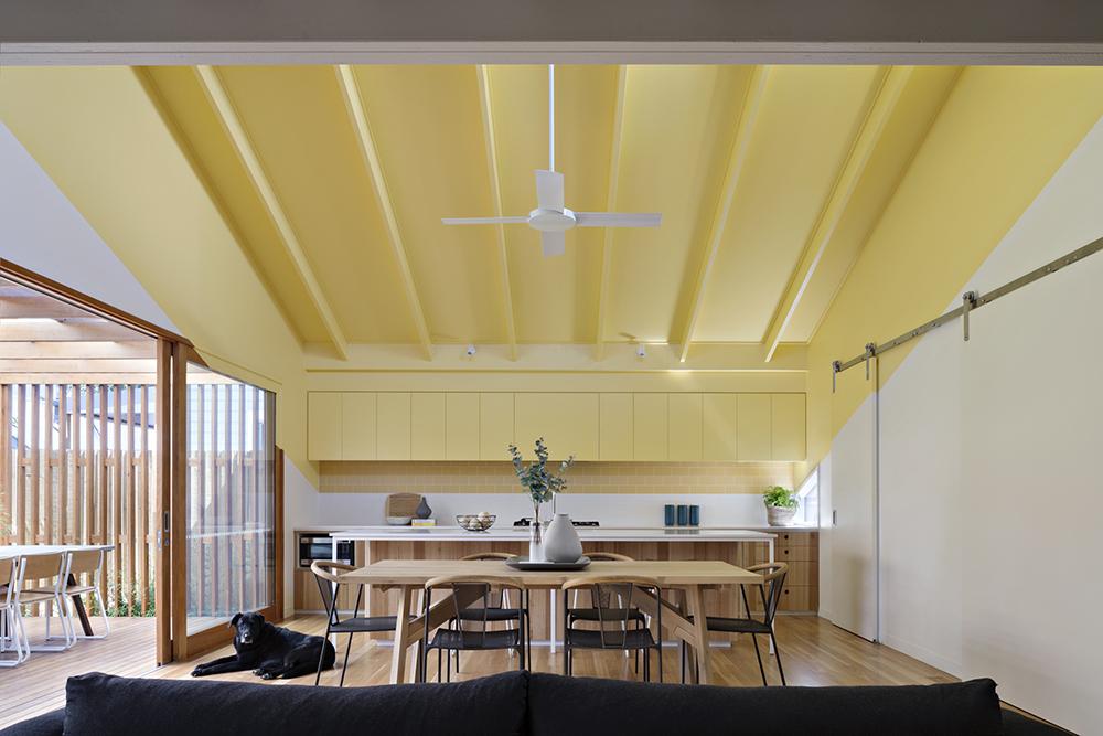 Joyful House yellow living area