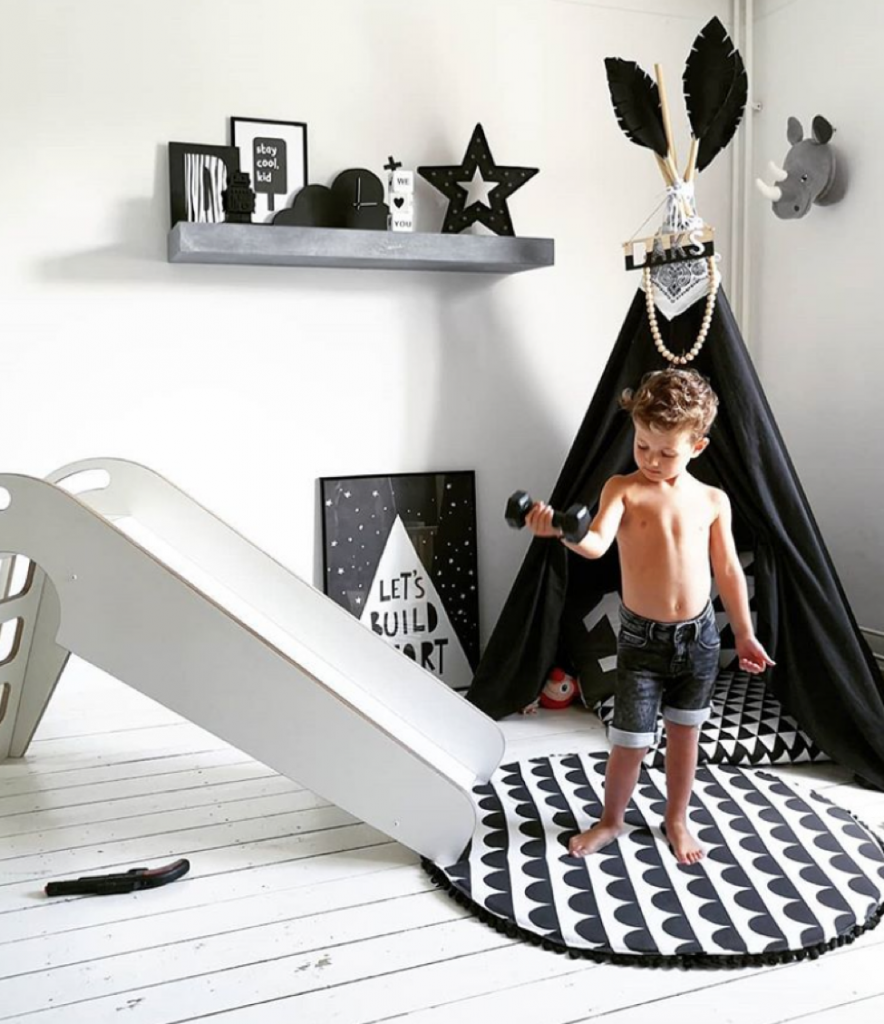 Little boys black and white room with teepee