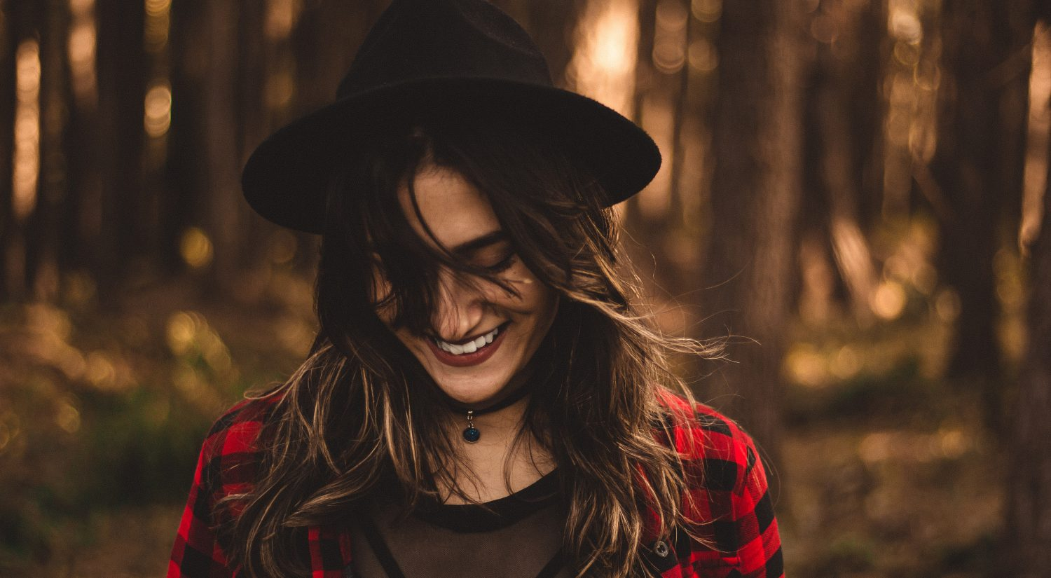 Women smiling in the woods