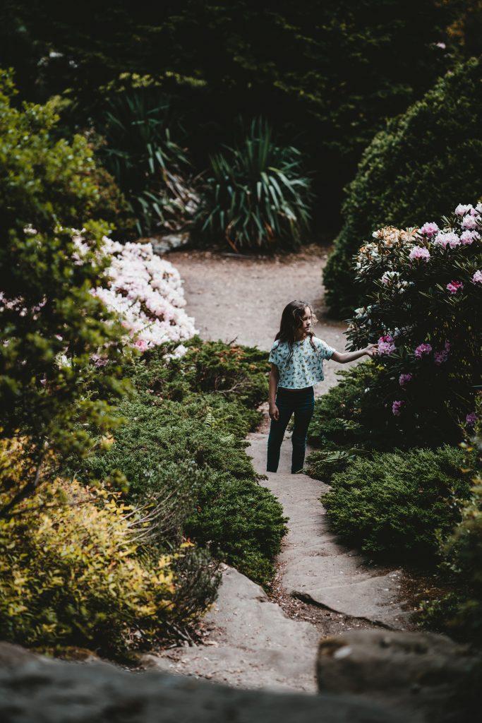 Young girl exploring in garden