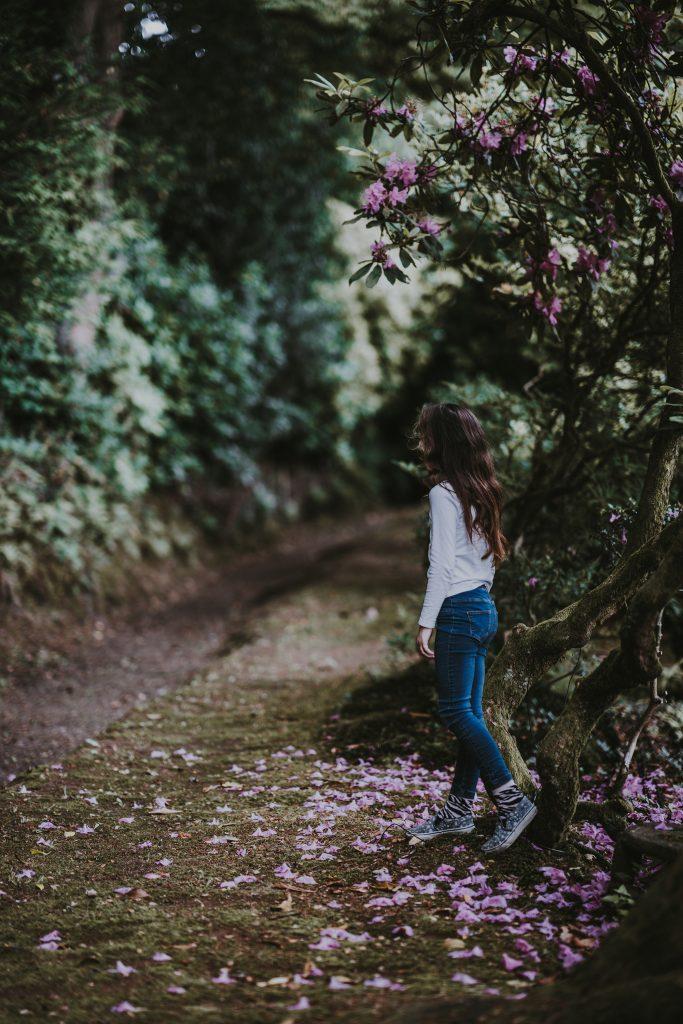 Young girl walking in garden