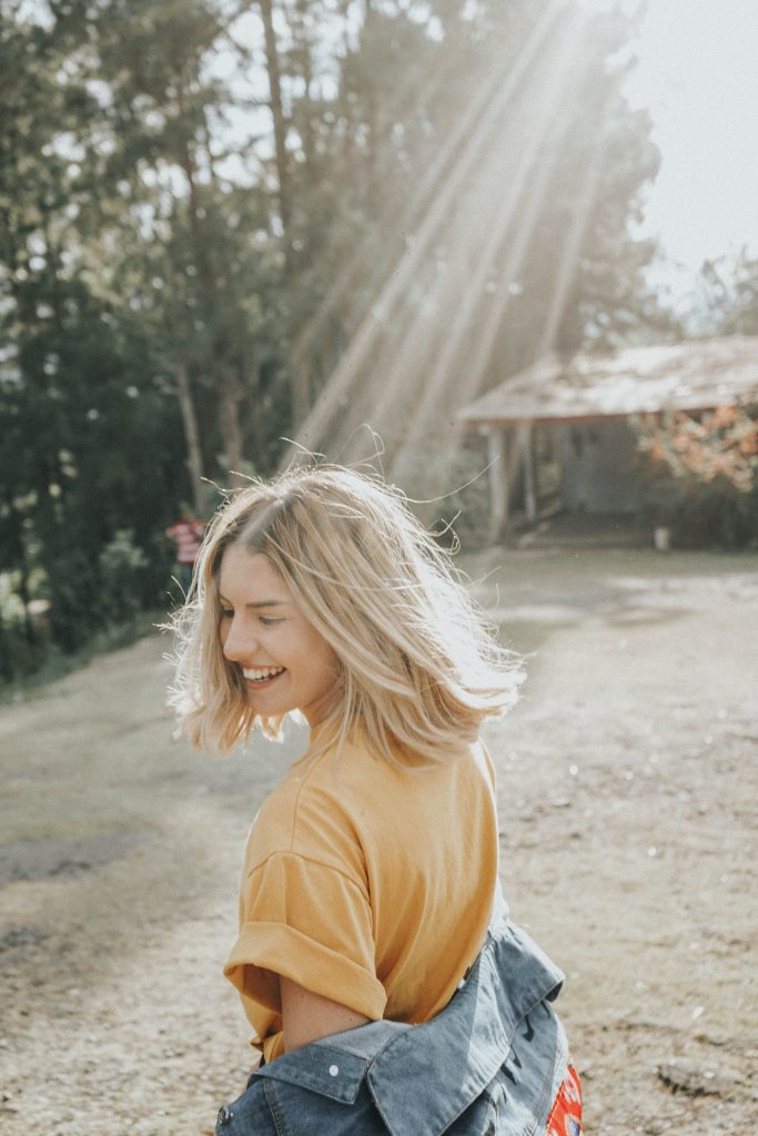Happy woman outdoors in sunshine