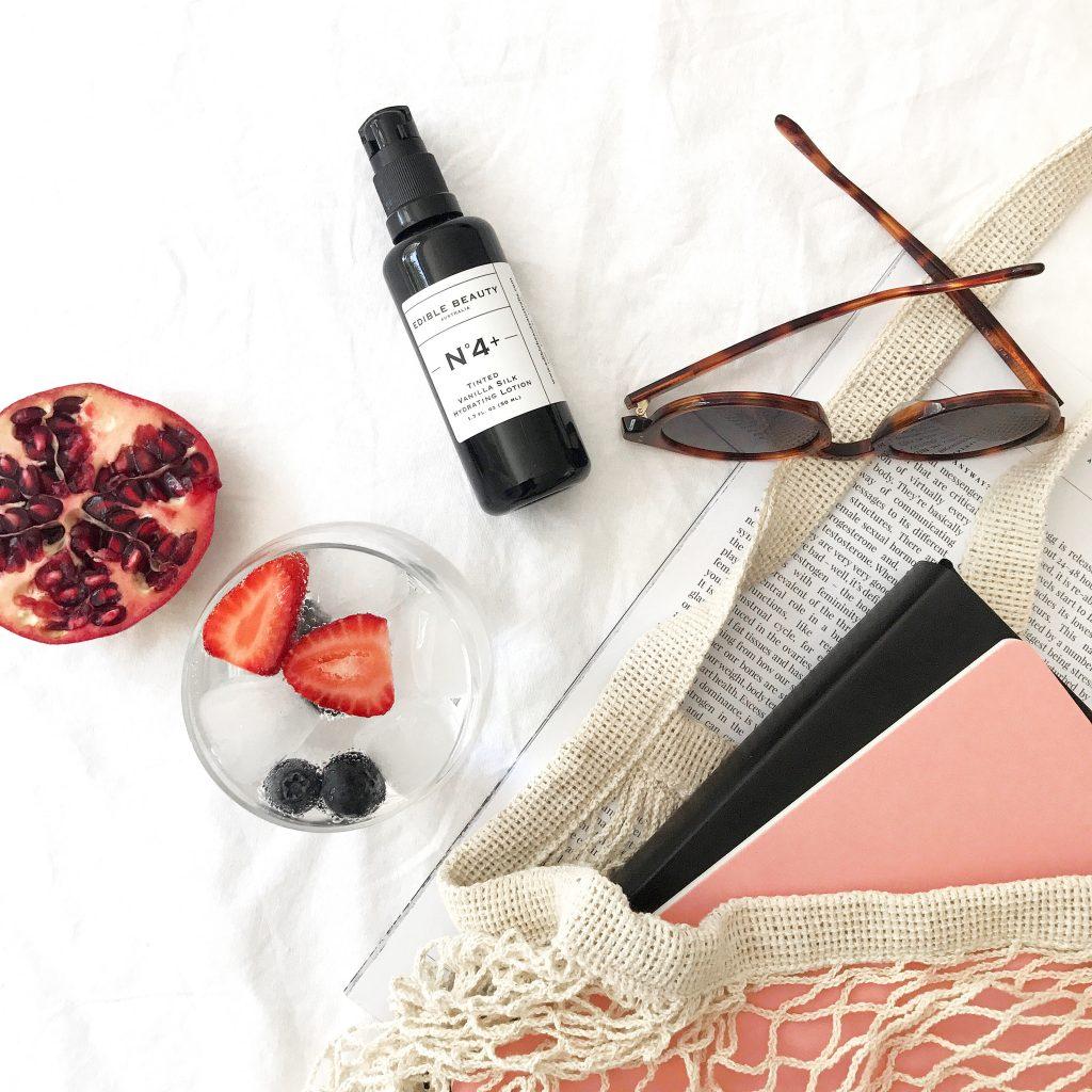 Edible Beauty Tinted vanilla silk flatly wth fruit bag and sunglasses