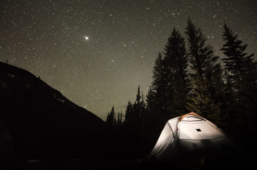 Camping tent set up under stars