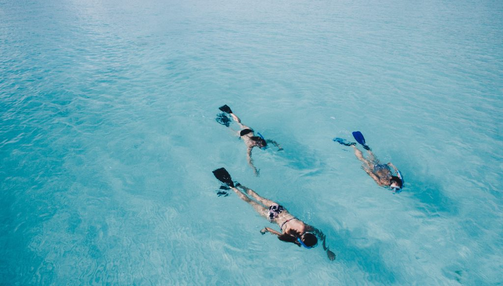 Mother and children snorkelling