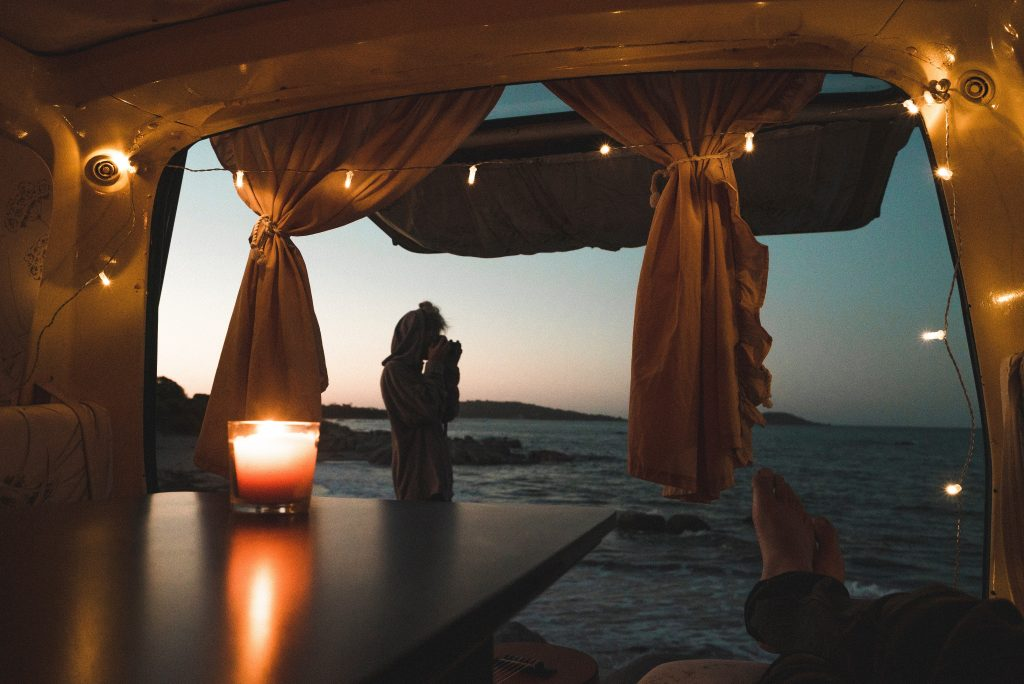 Caravan at night with candles and fairy lights