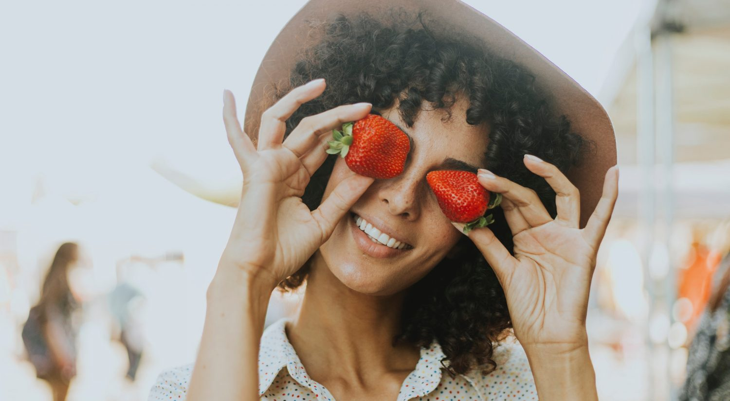 Beautiful healthy woman with strawberries