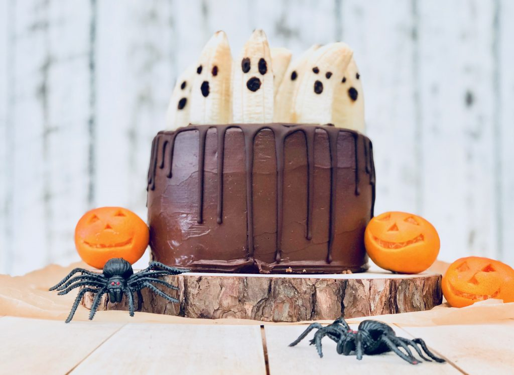 Halloween chocolate cake and ghost decorations