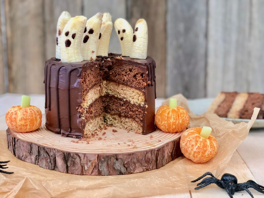 Halloween chocolate cake with marble inside and ghost decorations
