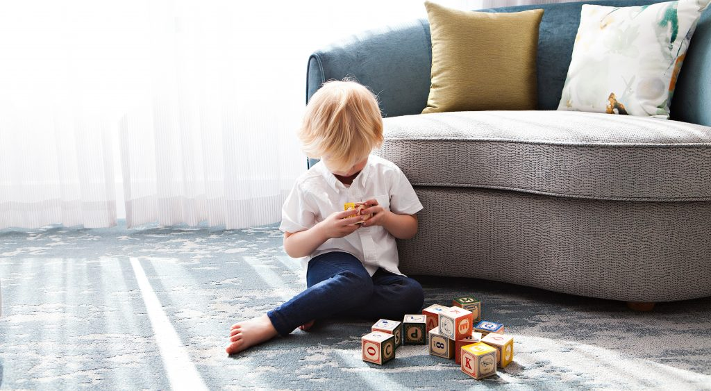 Little boy playing with blocks at home