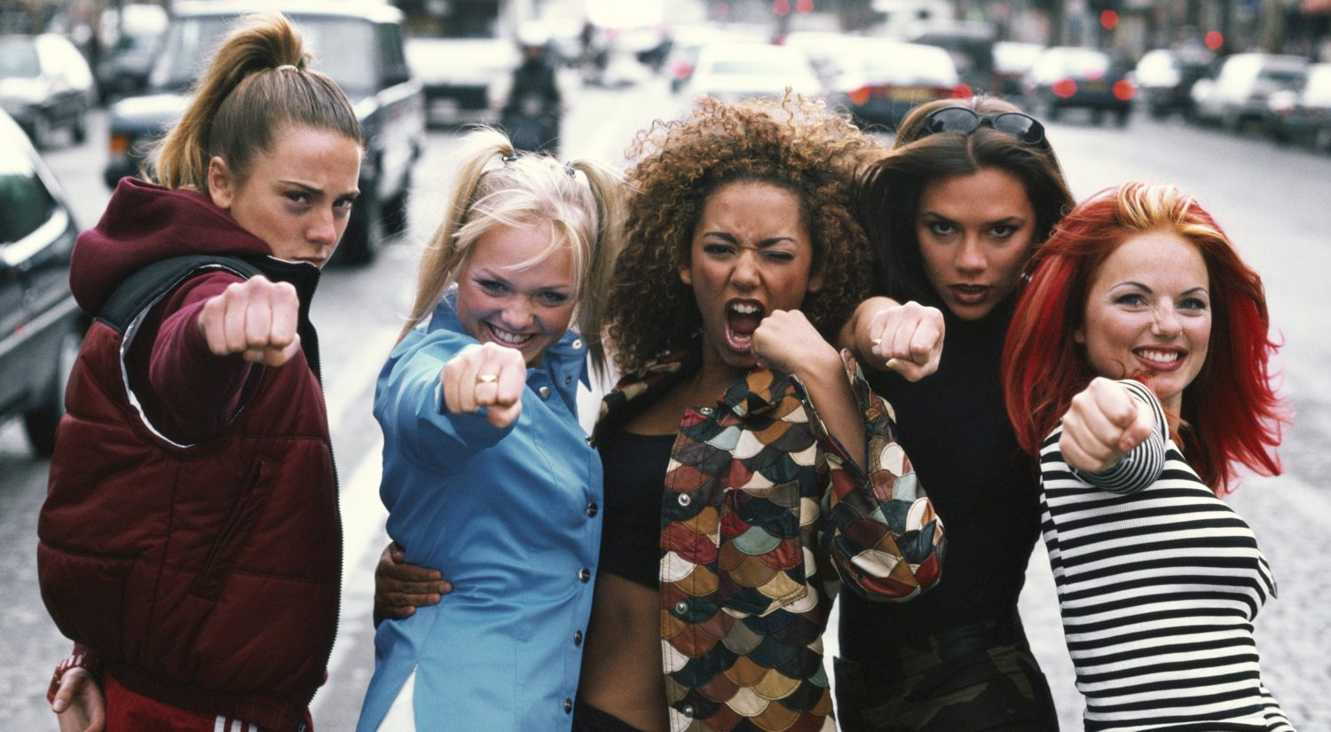 The Spice Girls standing on street