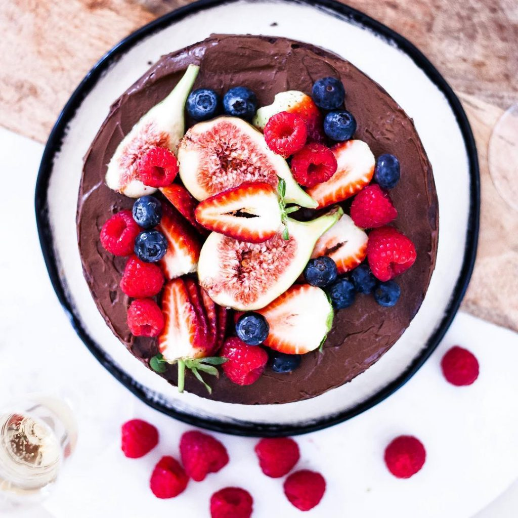Top view Whole Vegan Pantry Raw chocolate cake with ganache and raspberries