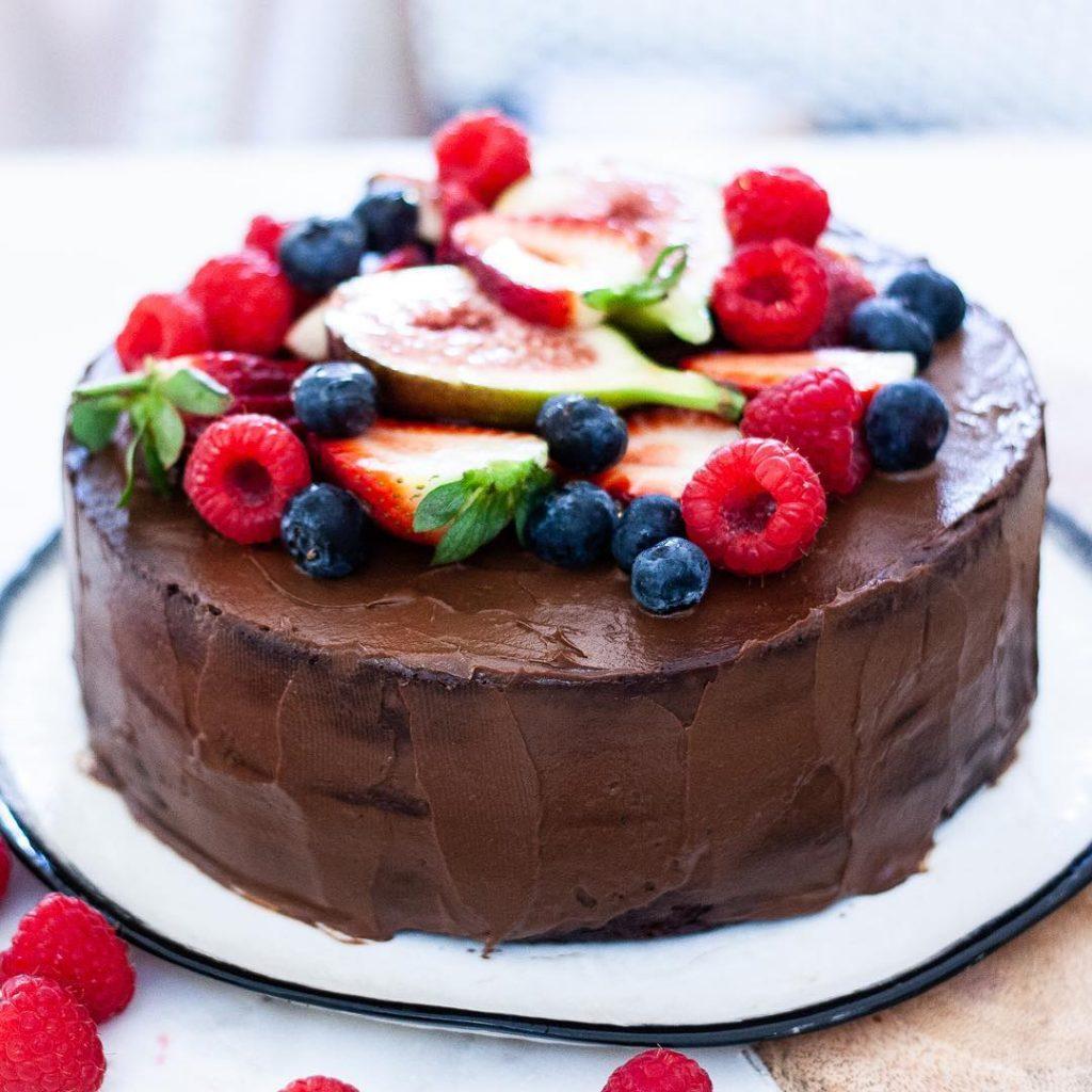 Whole Vegan Pantry Raw chocolate cake with ganache and raspberries full view