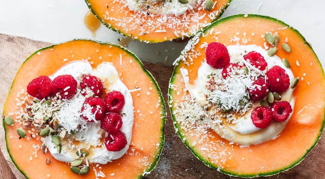 Whole Vegan Pantry Rockmelons with coyo, granola, seeds, coconut, raspberries, maple