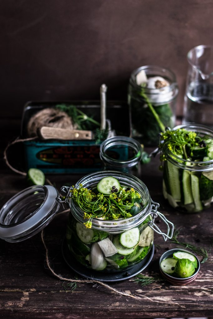 Green vegetables in glass jars