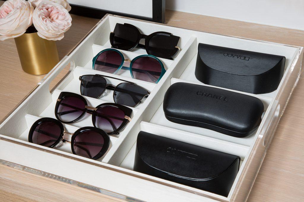 Sunglasses organised in wardrobe