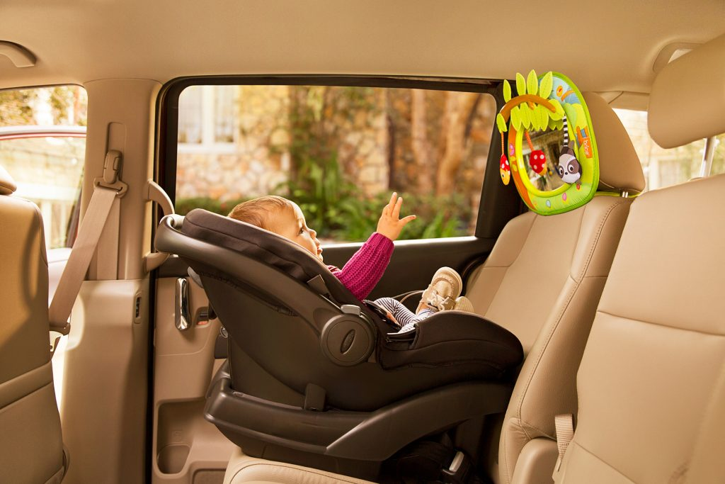 Baby in car seat with Brica by Munchkin mirror