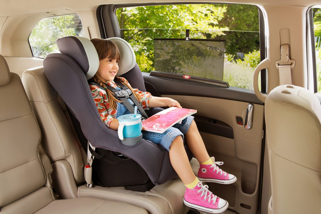 Girl in car seat with Brica by Munchkin sun shade on window