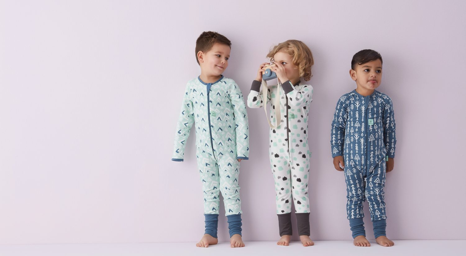 Three little kids standing in ergoPouch sleepwear