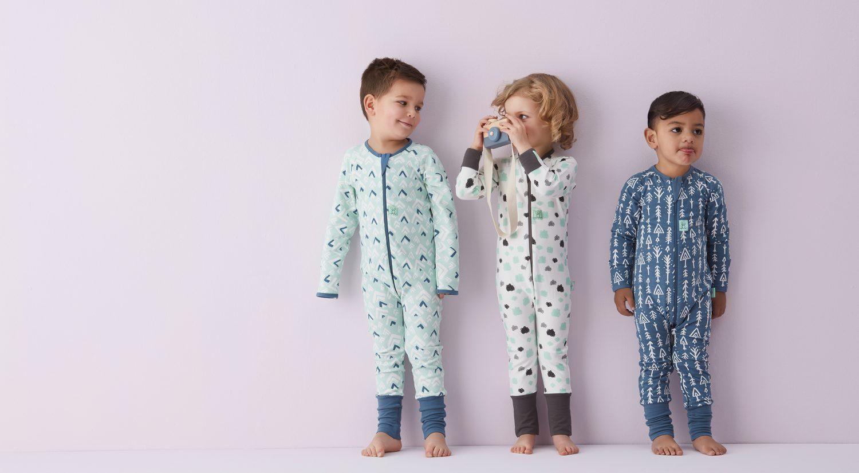 Three little kids standing in ergoPouch sleepwear