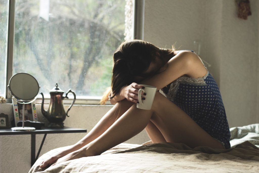 Contraception Options After Pregnancy mama disrupt Woman sitting on bed tired with cup of tea