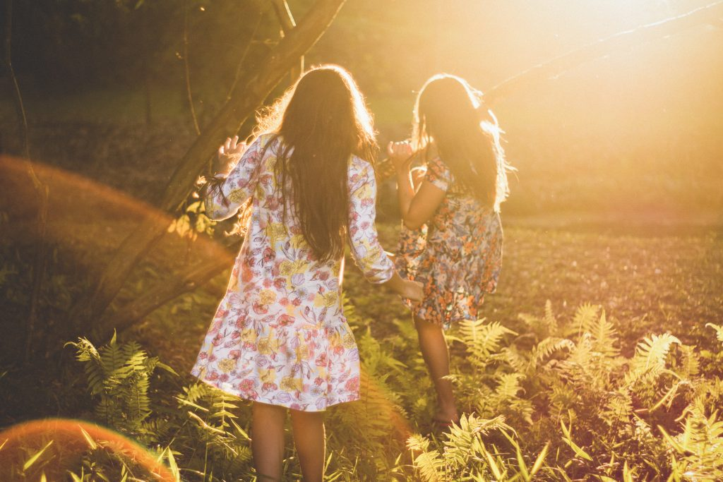 Two girls playing in garden