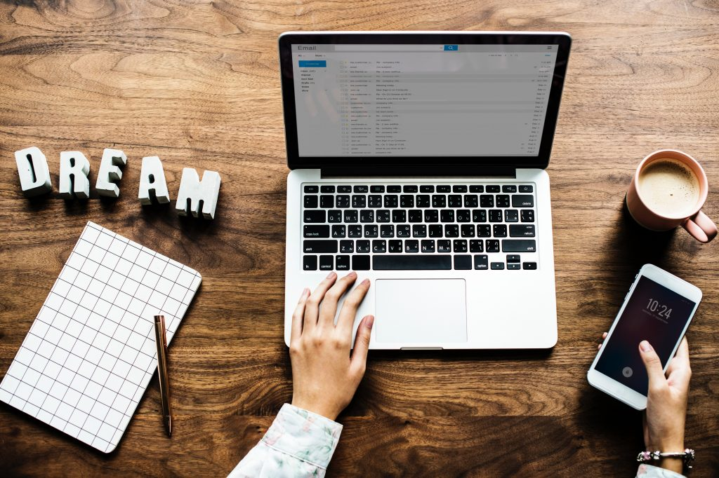 Laptop on desk with dream sign