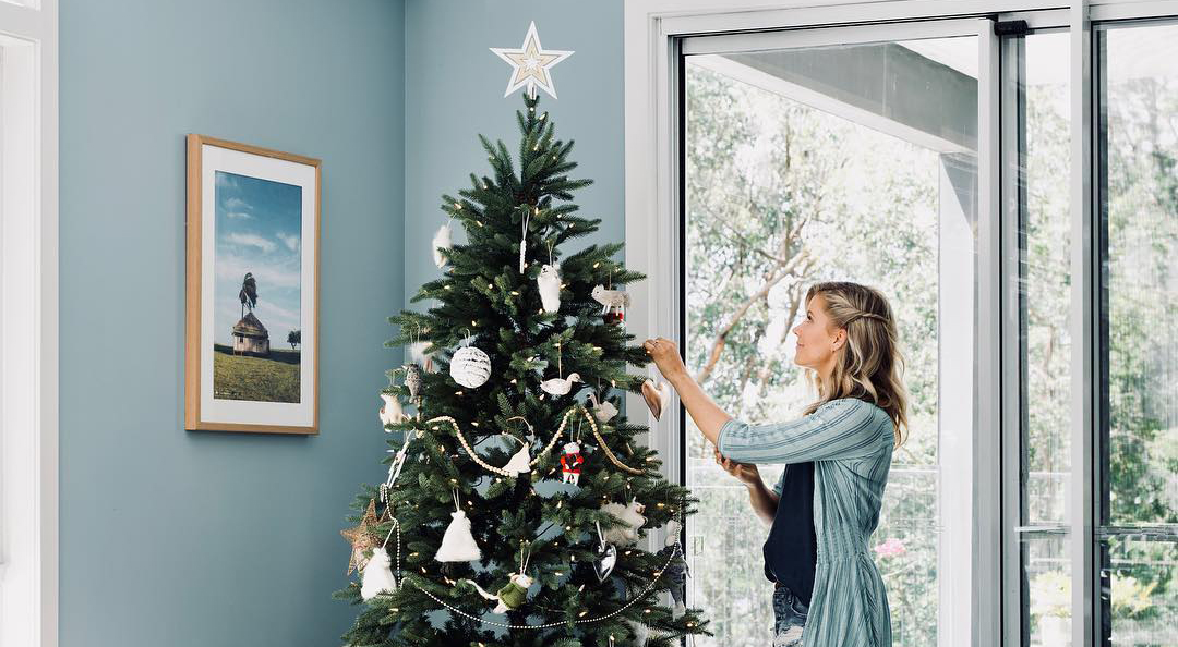 Carlene Duffy decorating her Christmas tree