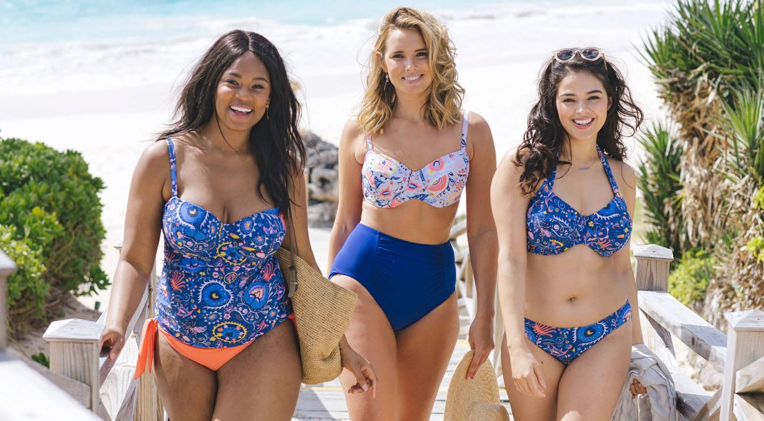 Curvy women on beach wearing LILLY & LIME