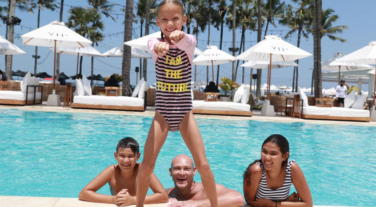 Miachel Klim with kids in swimming pool