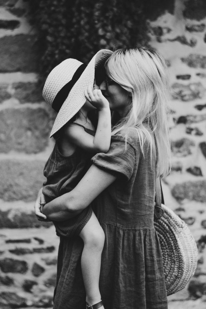 Mum carrying little girl