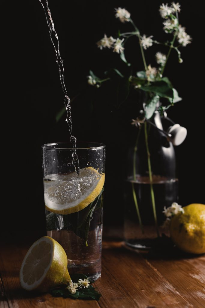 Water glass with lemon