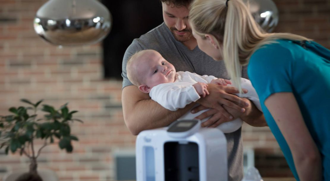 Mum and dad feeding baby with Tommee Tippee Perfect Prep Day & Night