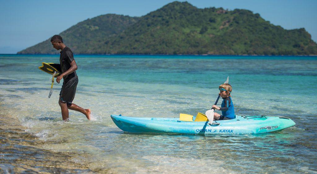 Nanuku child kayaking on private island
