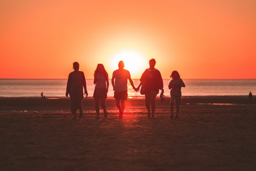 Family at the beach at sunset